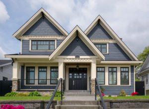 Large, elegant home with beautifully installed siding